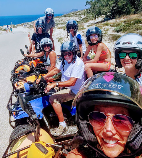 A group, including Christine, on mopeds.